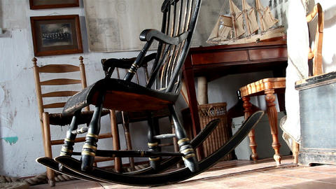 The rocking chair and other things on the room Footage
