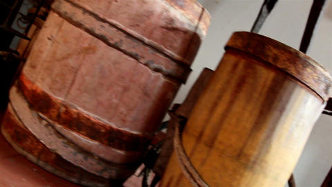 Three old barrels inside a room Footage