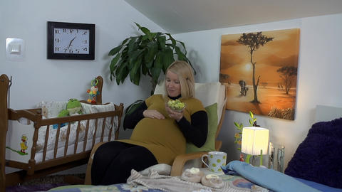 Future mother is caressing her big belly with spec Footage