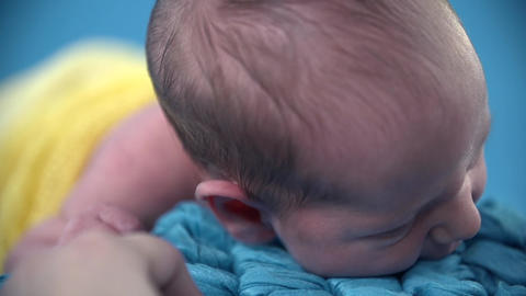 Baby lies on the belly and moves it's head around Footage