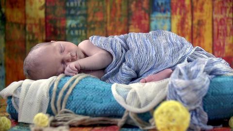 Baby Is Sleeping In Oriental Looking Set stock footage