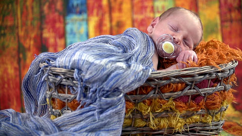 Baby covered with bluish cover sleeps in the styli Live Action