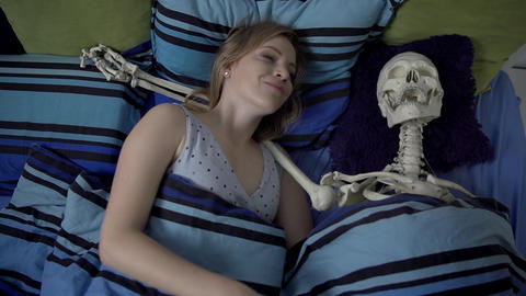 Woman Laying In The Bed With Skeleton stock footage