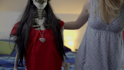 Hanging out with a skeleton dressed in red shirt a Footage