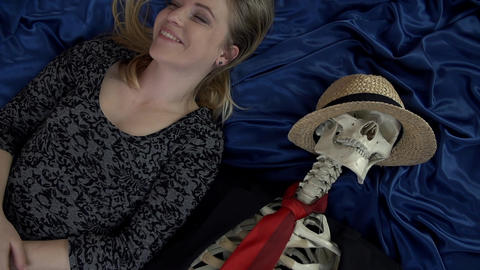 Female smiling out loud and touching the bones of  Footage
