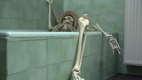Skeleton laying in the bathtub taking care of his  Live Action