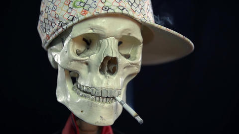 Close frontal shot of corpse having a smoke Footage