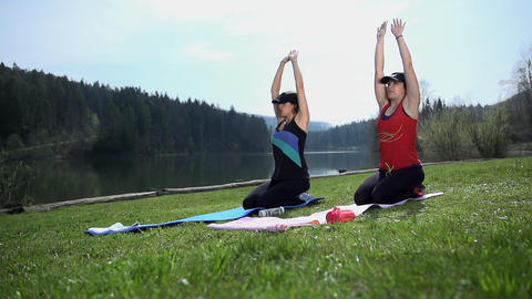 Two Pretty Ladies Doing Breathing Yoga Exercise At stock footage