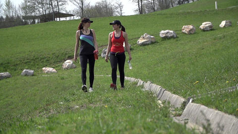 Two Fit Friends Walking On Grass After Sporting Sl Footage