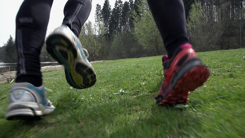 Close Up On Shoes Running On Grass in Slow Motion Footage