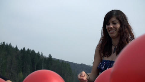Close Up On Girl In Dress Playing With Red Balloon stock footage