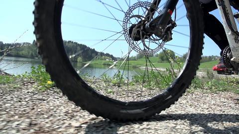 Bikes wheel on a gravel road Footage