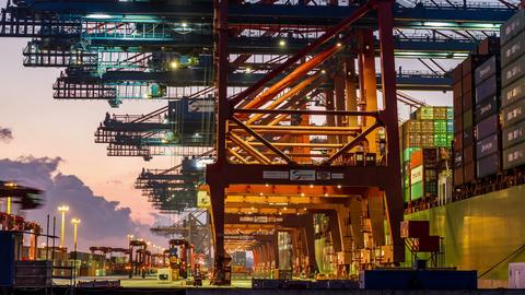4K hamburg harbor loading container on ship - DSLR Footage