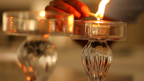 lighting candles for a romantic dinner Stock Video Footage