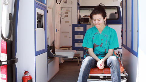 nurse thinking in ambulance 2 Footage