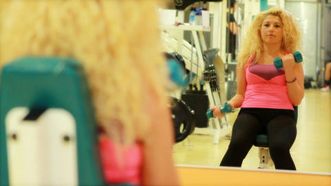girl using dumbles in a gym Stock Video Footage