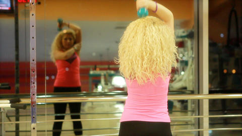 girl using dumbles in a gym 3 Stock Video Footage