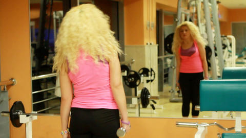 girl using dumbles in a gym 4 Stock Video Footage