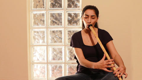 young woman playing flute Stock Video Footage