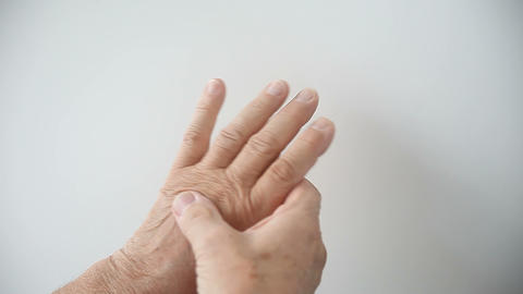 man massages pain in his palm Footage