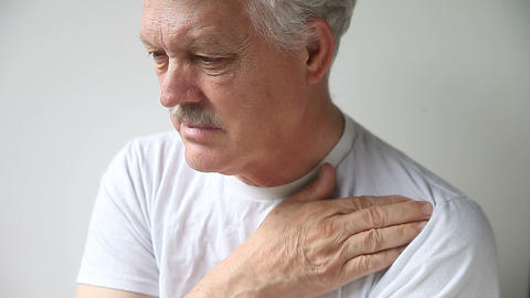 man scratches shoulder Footage