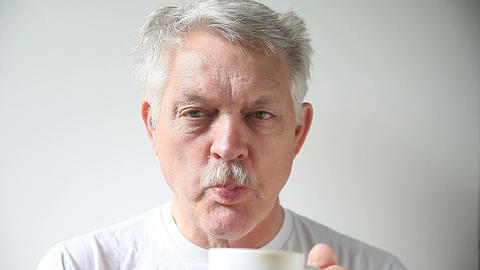 man drinking coffee Live Action
