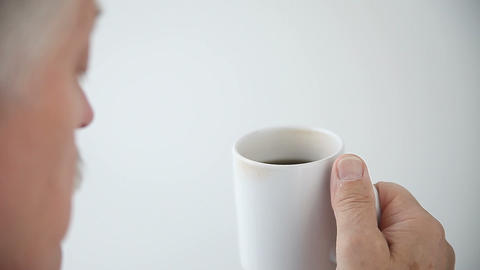 man drinks cup of coffee Live Action