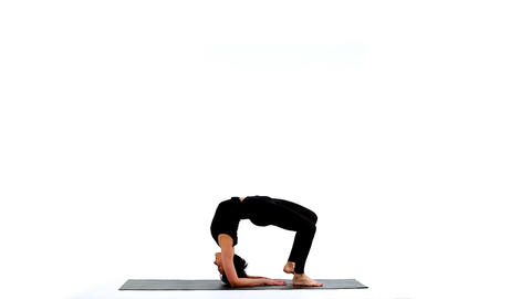 Young woman exercise yoga asana wheel on white Footage