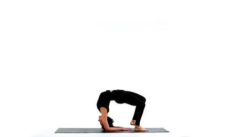 Young woman exercise yoga asana wheel on white Footage