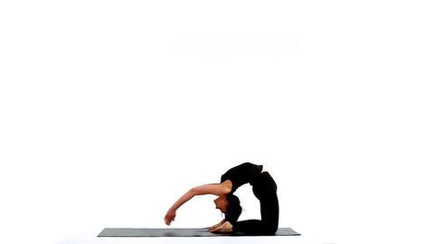 Young woman exercise yoga asana wheel on white Stock Video Footage