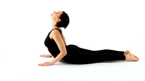 young woman exercise yoga asana on white Footage