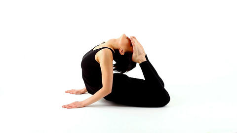 young woman exercise yoga asana on white Stock Video Footage