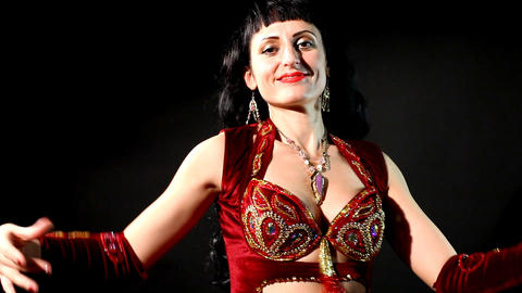 woman Belly dance in red- look and smile Stock Video Footage