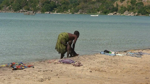 Malawi: african woman and a child washing Footage