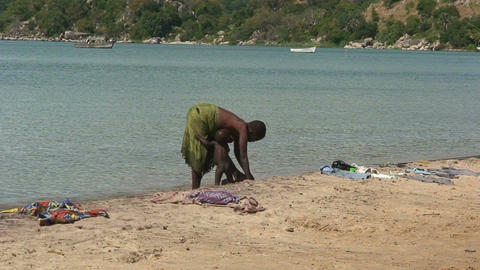 Malawi: african woman and a child washing Stock Video Footage
