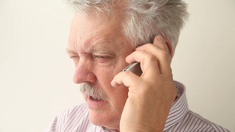 Angry Senior Man On Mobile Phone stock footage