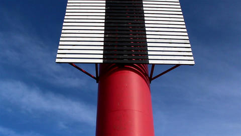A tall stripe colored lighthouse Footage