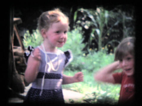 Family, Two Young Girls In Garden, Grandma stock footage
