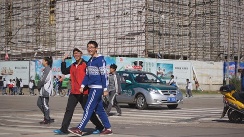 Chinese schoolers crossing the street Live Action