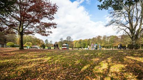 children's playground in windy city park in autumn Footage