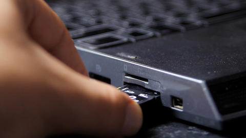 Hand Removing Micro SD Card From Laptop, Media, Te Live Action