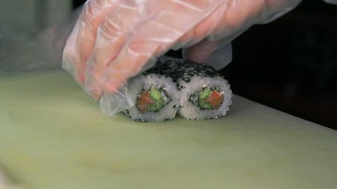 Chef slicing sushi rolls Footage