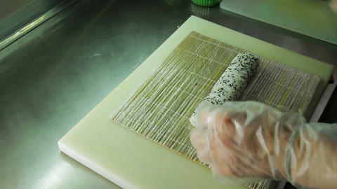 Rolling up the sushi roll with bamboo mat, upside Footage