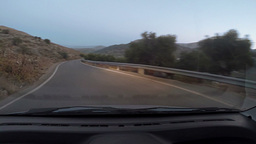 Narrow twisty road early evening Footage