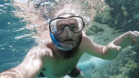Man snorkling POV GIF