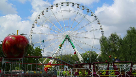Ferris Wheel And Rides In The Amusement Park - Tim stock footage