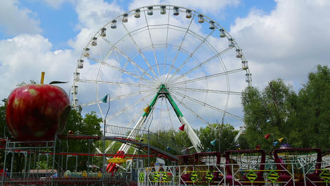 Ferris wheel and rides in the amusement park - tim Footage