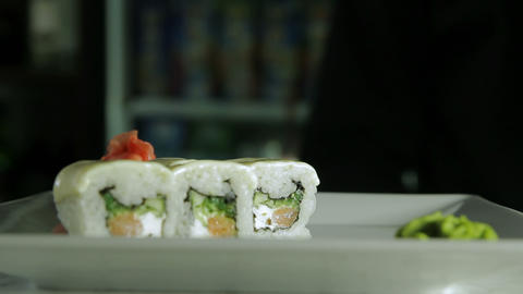 Cook serving japanese sushi rolls on a plate Footage