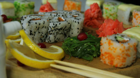 Dolly Shot Of Delicious Sushi Rolls On Wooden Plat stock footage