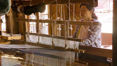 INLE LAKE. MYANMAR - CIRCA JAN 2014: Weaving Facto stock footage